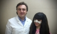 Александр Грудько с пациенткой после ринопластики